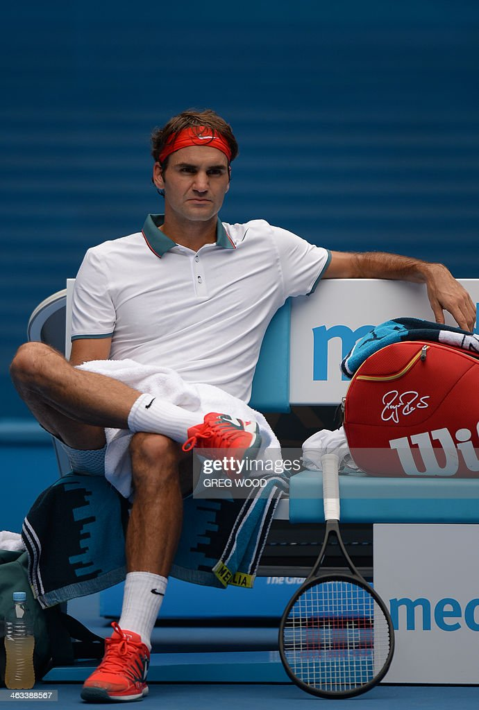 Switzerland's Roger Federer sits during his men's singles match against Russia's Teymuraz Gabashvili on day six of the 2014 Australian Open tennis tournament in Melbourne on January 18, 2014. IMAGE