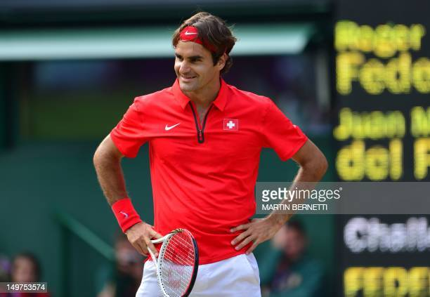 Switzerland's Roger Federer smiles in his game against Argentina's Juan Martin del Potro in the men's singles semi final match against at the 2012...