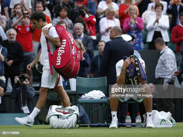 Switzerland's Roger Federer walks off court following his defeat to Ukraine's Sergiy Stakhovsky during day Three of the Wimbledon Championships at...
