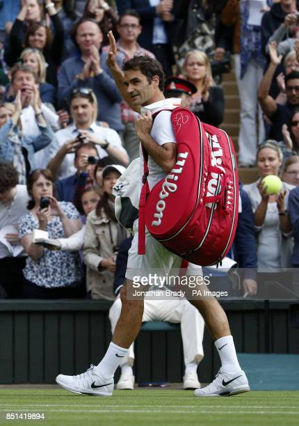 Switzerland's Roger Federer walks off the court after being defeated by Ukraine's Sergiy Stakhovsky during day Three of the Wimbledon Championships...