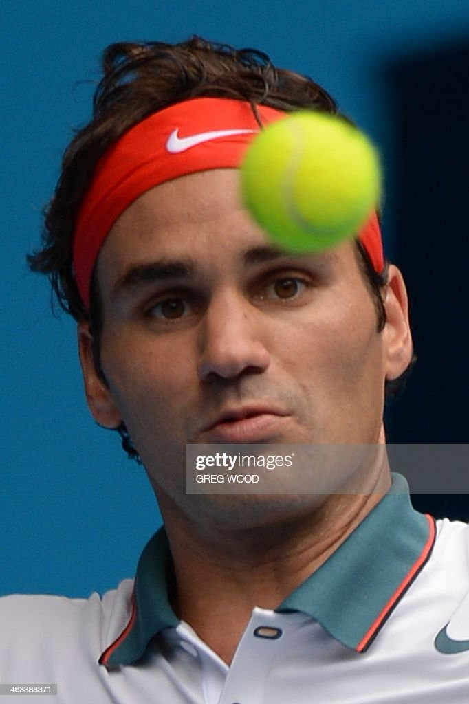 Switzerland's Roger Federer watches the ball as he plays a shot during his men's singles match against Russia's Teymuraz Gabashvili on day six of the 2014 Australian Open tennis tournament in Melbourne on January 18, 2014. IMAGE