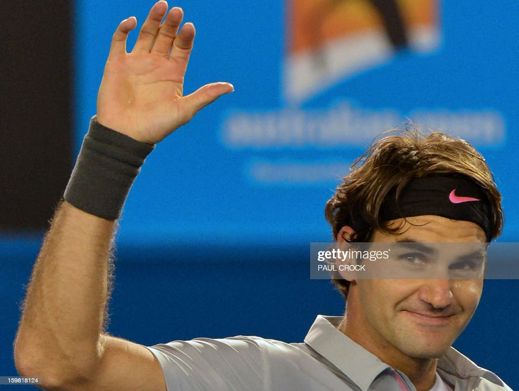 Switzerland's Roger Federer waves after victory in his men's singles match against Canada's Milos Raonic on the eighth day of the Australian Open tennis tournament in Melbourne on January 21, 2013. AFP PHOTO/ PAUL CROCK IMAGE STRICTLY RESTRICTED TO EDITORIAL USE - STRICTLY NO COMMERCIAL USE