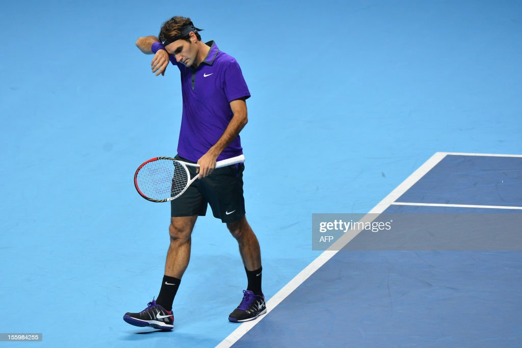 Switzerland's Roger Federer wipes his brow after a point against Argentina's Juan Martin Del Potro during their group B singles match in the round robin stage on the sixth day of the ATP World Tour Finals tennis tournament in London on November 10, 2012.