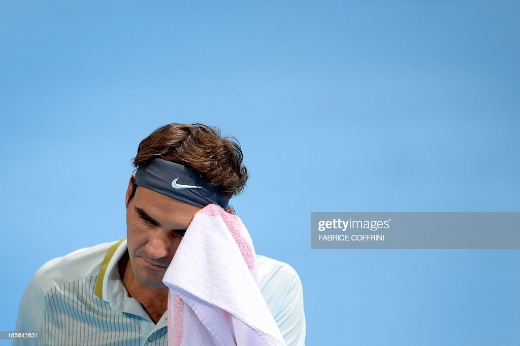 Switzerland's Roger Federer wipes his face during his match against Uzbekistan's Denis Istomin on October 23, 2013 at the Swiss Indoors tennis tournament in Basel.