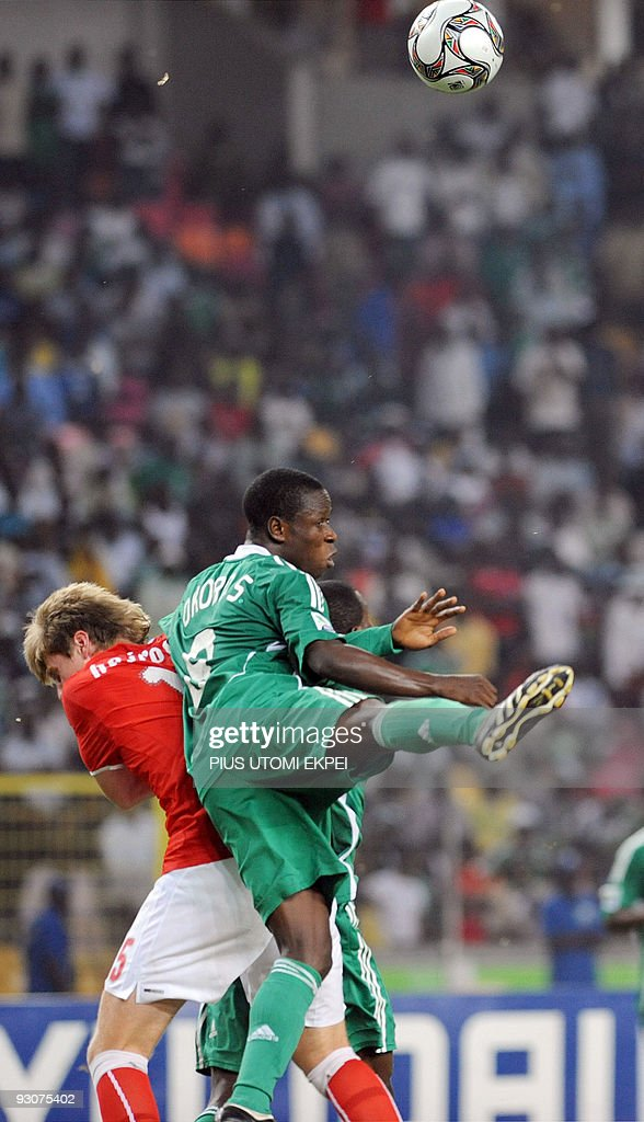 Switzerland's Saed Hajrovic and Nigeria's Stanley Okoro struggle for possession of the ball during the final of FIFA U17 World Cup in Abuja on...
