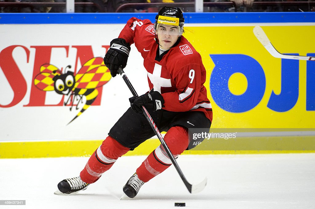 Switzerland's Samuel Kreis controls the puck during the Group B preliminary round match Switzerland vs Sweden at the IIHF World Junior Ice Hockey Championships in Malmoe, Sweden on December 26, 2013. Sweden won 5-3 against Switzerland. AFP PHOTO / TT NEWS AGENCY / LUDVIG THUNMAN OUT**