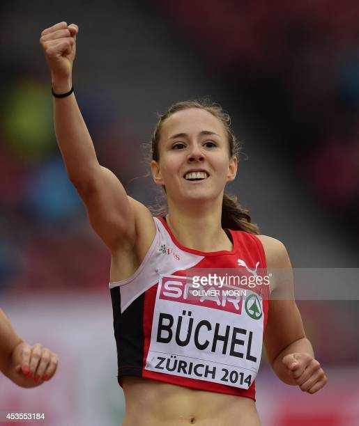 Switzerland's Selina Buchel celebrates her victory after crossing the finish line of a Women's 800m heat during the European Athletics Championships...