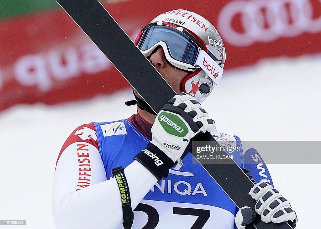 Switzerland's Silvan Zurbriggen kisses his ski at finish line during the men's downhill event of the 2013 Ski World Championships in Schladming, Austria on February 9, 2013.
