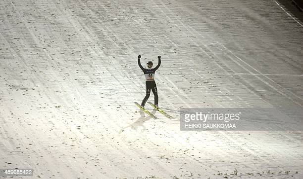 Switzerland's Simon Ammann celebrates his victory in the FIS Ski Jumping HS 142 World Cup event in Ruka Kuusamo Finland on November 28 2014 AFP PHOTO...