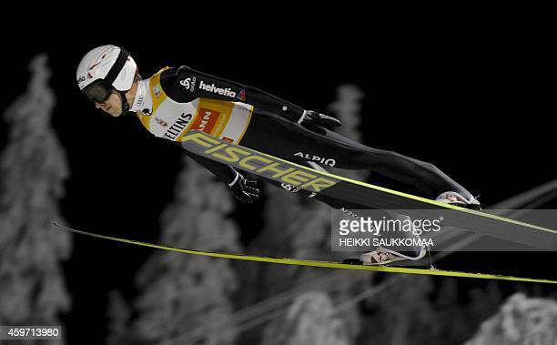 Switzerland's Simon Ammann competes during the FIS Ski Jumping HS 142 World Cup in Ruka Kuusamo Finland on November 29 2014 Switzerland's Simon...