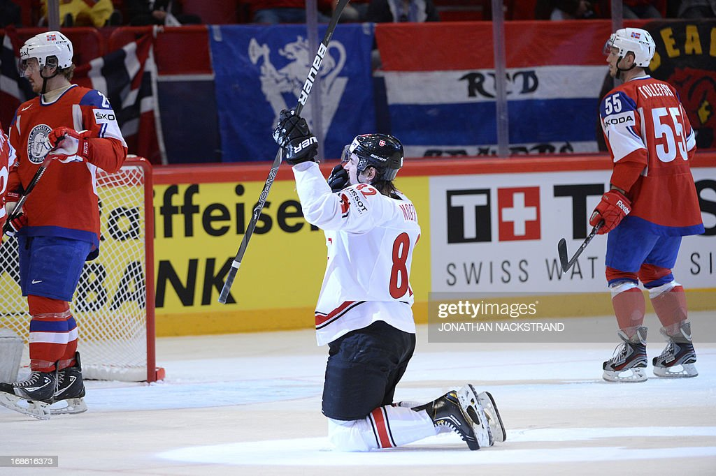 Switzerland's Simon Moser (C) celebrates after scoring during the preliminary round match Norway vs Switzerland at the 2013 IIHF Ice Hockey World Championships on May 12, 2013 in Stockholm.