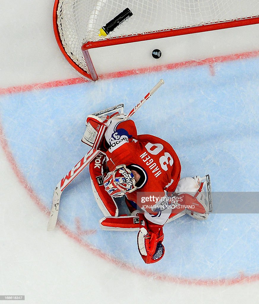 Switzerland's Simon Moser (unseen) scores on Norway's goalkeeper Lars Haugen during the preliminary round match Norway vs Switzerland at the 2013 IIHF Ice Hockey World Championships on May 12, 2013 in Stockholm.