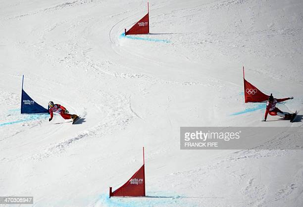 Switzerland's Simon Schoch and Switzerland's Kaspar Fluetsch compete in the Men's Snowboard Parallel Giant Slalom 1/8 Finals at the Rosa Khutor...