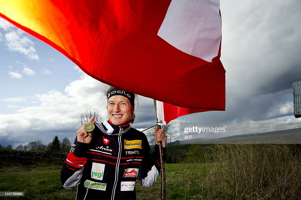 Switzerland's Simone Niggli poses with her gold medal and Swiss flag after winning the Women's European Trail-Orienteering Championship long distance final in Orsa, on May 18, 2012. AFP PHOTO / JENS L