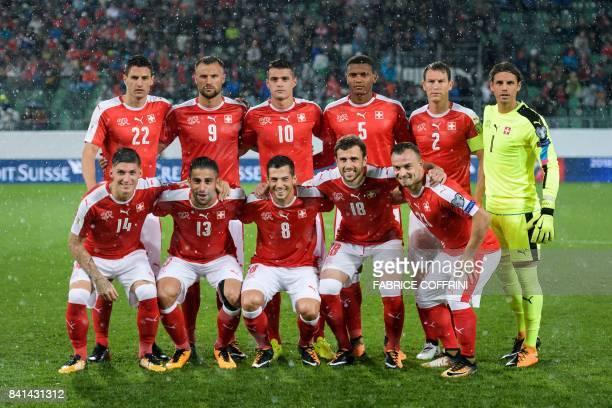 Switzerland's squad defender Fabian Schar foward Haris Seferovic midfielder Granit Xhaka defender Manuel Akanji midfielder Stephan Lichtsteiner and...