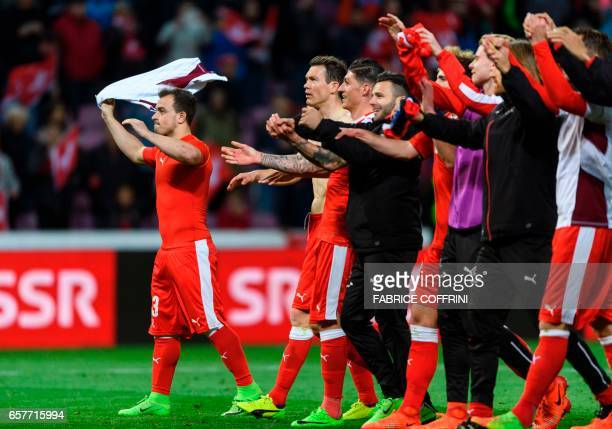 Switzerland's squad with Swiss forward Xherdan Shaqiri celebrate their victory at the end FIFA World Cup 2018 qualifying football match between...