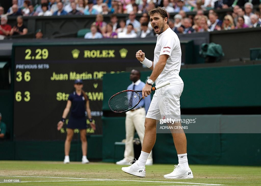 Switzerland's Stan Wawrinka celebrates a point against Argentina's Juan Martin del Potro during their men's singles second round match on the fifth day of the 2016 Wimbledon Championships at The All England Lawn Tennis Club in Wimbledon, southwest London, on July 1, 2016. / AFP / ADRIAN