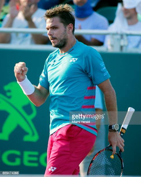 Switzerland's Stan Wawrinka reacts after winning a game against Germany's Alexander Zverev in the fourth round of the Miami Open at Crandon Park...