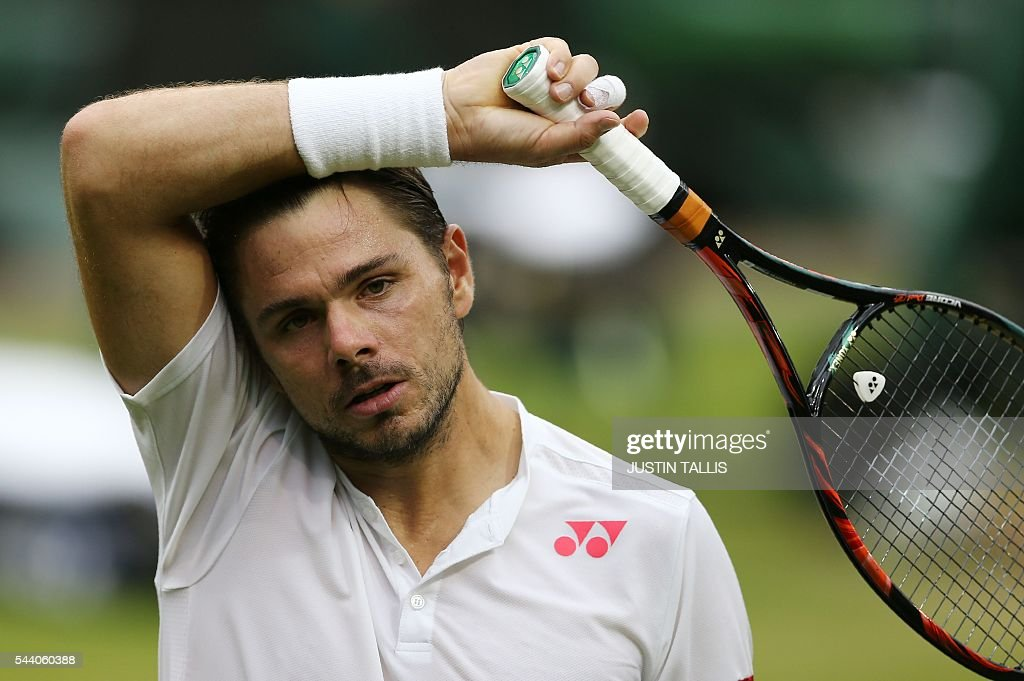Switzerland's Stan Wawrinka reacts while playing Argentina's Juan Martin del Potro during their men's singles second round match on the fifth day of the 2016 Wimbledon Championships at The All England Lawn Tennis Club in Wimbledon, southwest London, on July 1, 2016. / AFP / JUSTIN