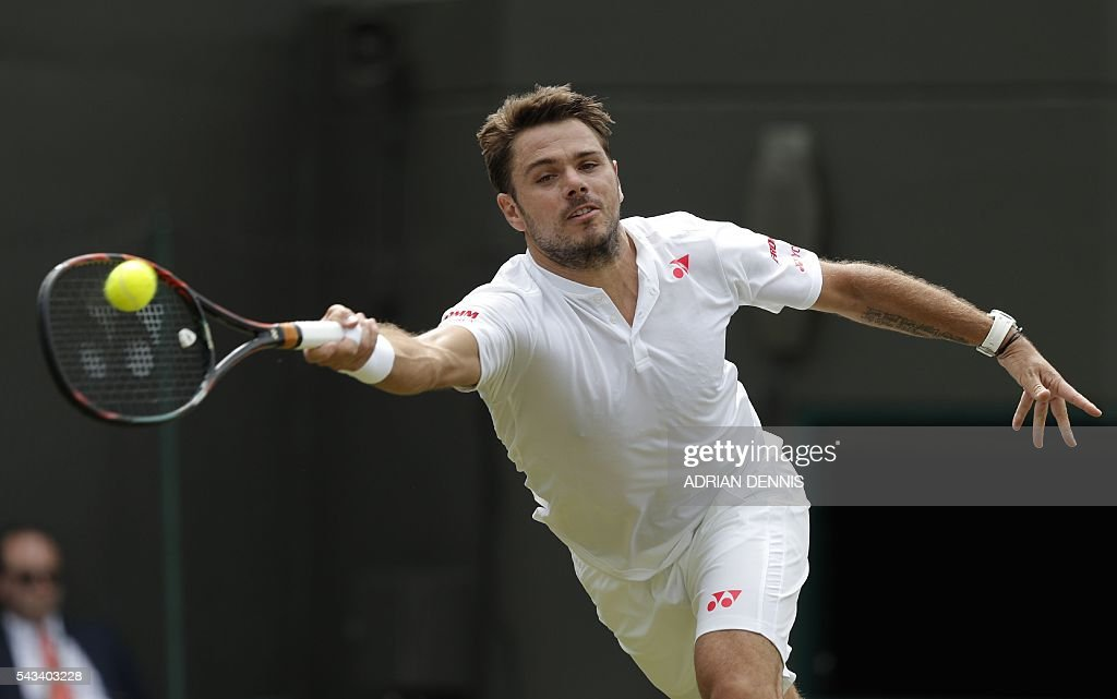 Switzerland's Stan Wawrinka returns against US player Taylor Fritz during their men's singles first round match on the second day of the 2016 Wimbledon Championships at The All England Lawn Tennis Club in Wimbledon, southwest London, on June 28, 2016. / AFP / ADRIAN
