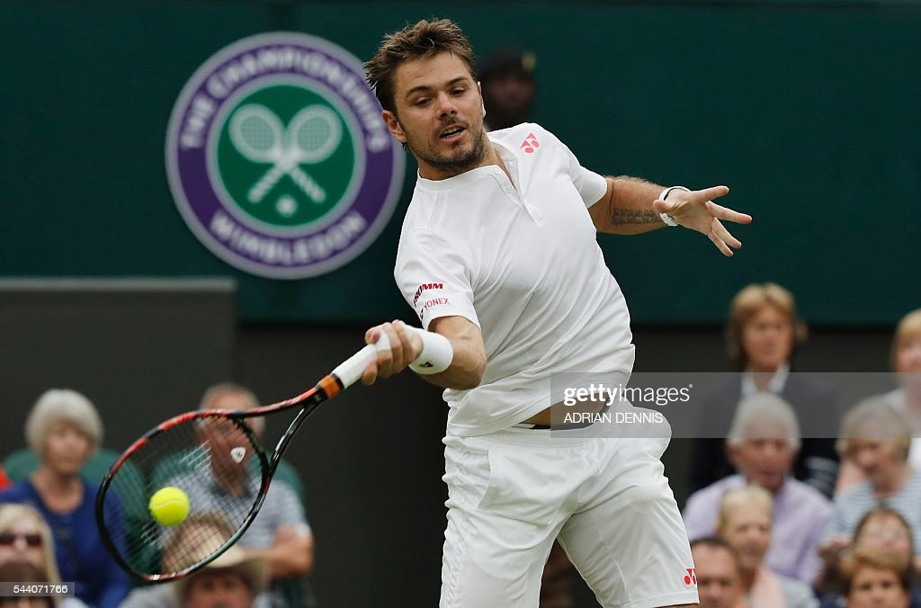 Switzerland's Stan Wawrinka returns to Argentina's Juan Martin del Potro during their men's singles second round match on the fifth day of the 2016 Wimbledon Championships at The All England Lawn Tennis Club in Wimbledon, southwest London, on July 1, 2016. / AFP / ADRIAN