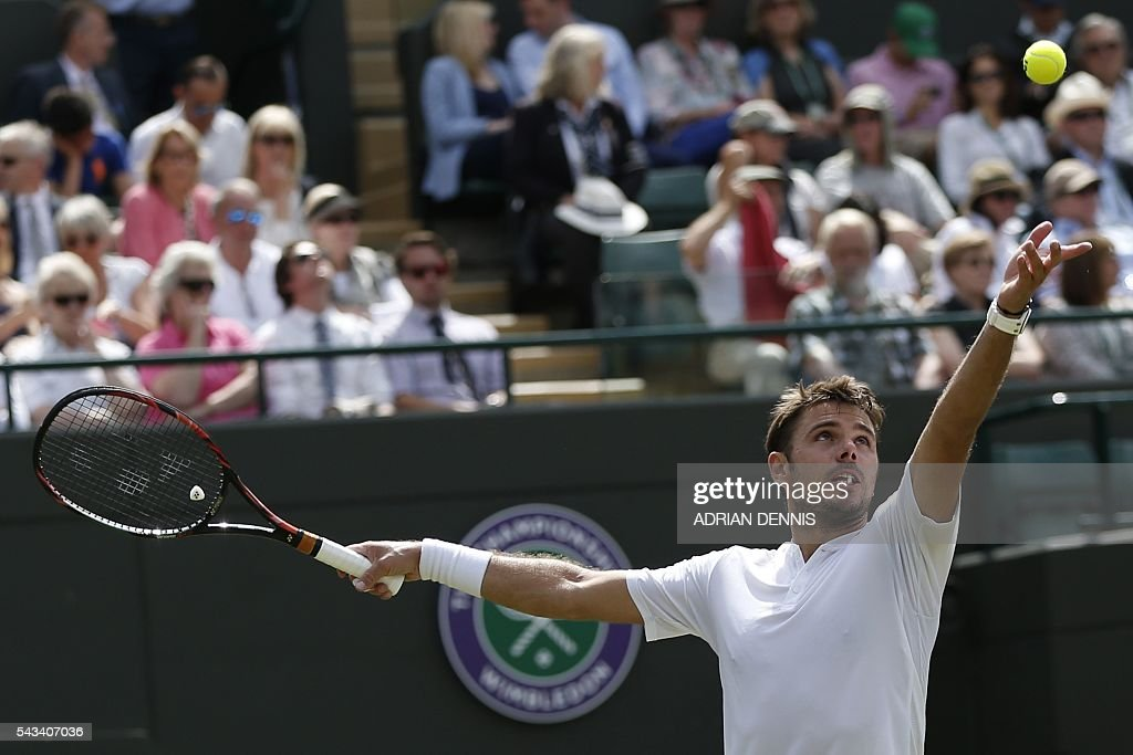 Switzerland's Stan Wawrinka serves against US player Taylor Fritz during their men's singles first round match on the second day of the 2016 Wimbledon Championships at The All England Lawn Tennis Club in Wimbledon, southwest London, on June 28, 2016. / AFP / ADRIAN