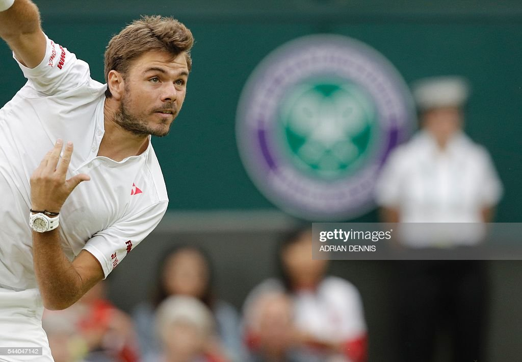 Switzerland's Stan Wawrinka serves to Argentina's Juan Martin del Potro during their men's singles second round match on the fifth day of the 2016 Wimbledon Championships at The All England Lawn Tennis Club in Wimbledon, southwest London, on July 1, 2016. / AFP / ADRIAN