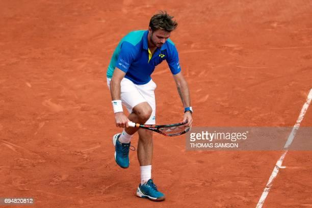 TOPSHOT Switzerland's Stanislas Wawrinka breaks his racket during the men's final tennis match against Spain's Rafael Nadal at the Roland Garros 2017...