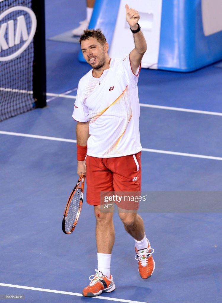 Switzerland's Stanislas Wawrinka celebrates after victory in his men's singles match against Spain's Tommy Robredo on day seven of the 2014 Australian Open tennis tournament in Melbourne on January 19, 2014. IMAGE