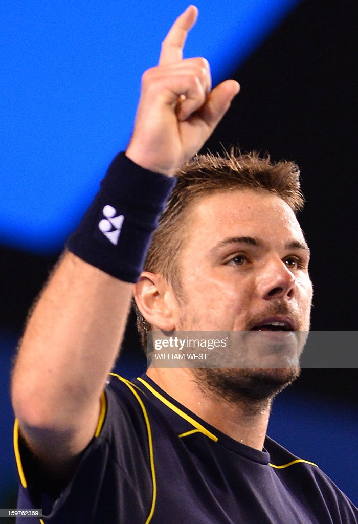 Switzerland's Stanislas Wawrinka gestures during his men's singles match against Serbia's Novak Djokovic on the seventh day of the Australian Open tennis tournament in Melbourne on January 20, 2013.