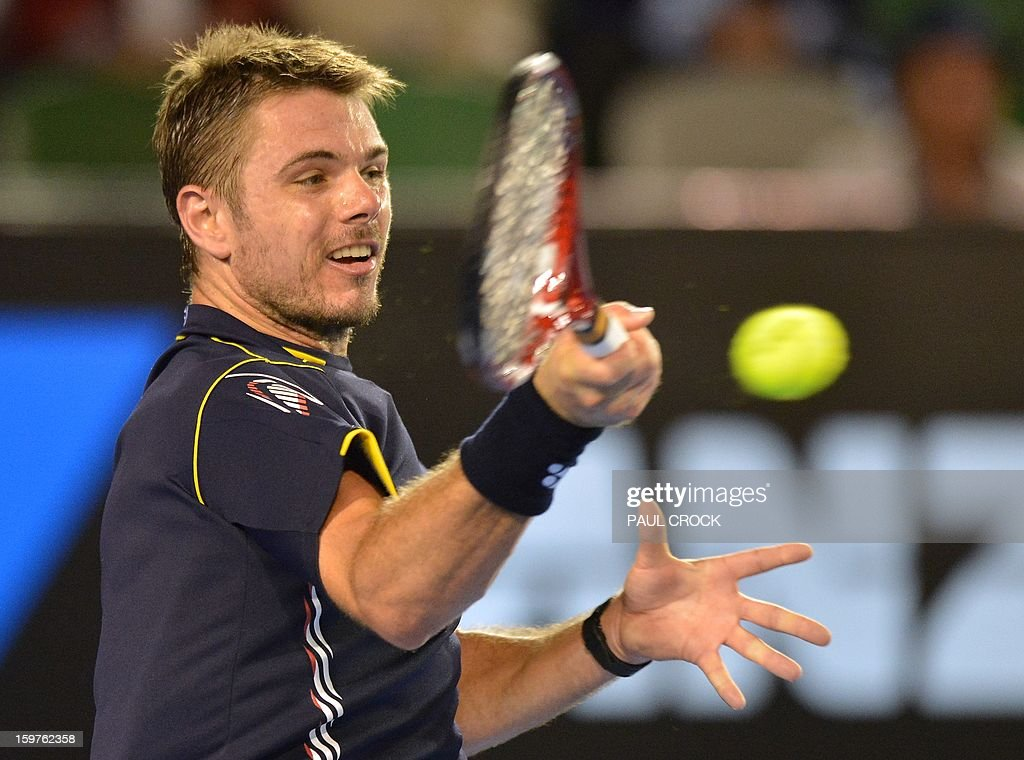 Switzerland's Stanislas Wawrinka hits a return against Serbia's Novak Djokovic during their men's singles match on day seven of the Australian Open tennis tournament in Melbourne on January 20, 2013. AFP PHOTO / PAUL CROCK IMAGE STRICTLY RESTRICTED TO EDITORIAL USE - STRICTLY NO COMMERCIAL USE