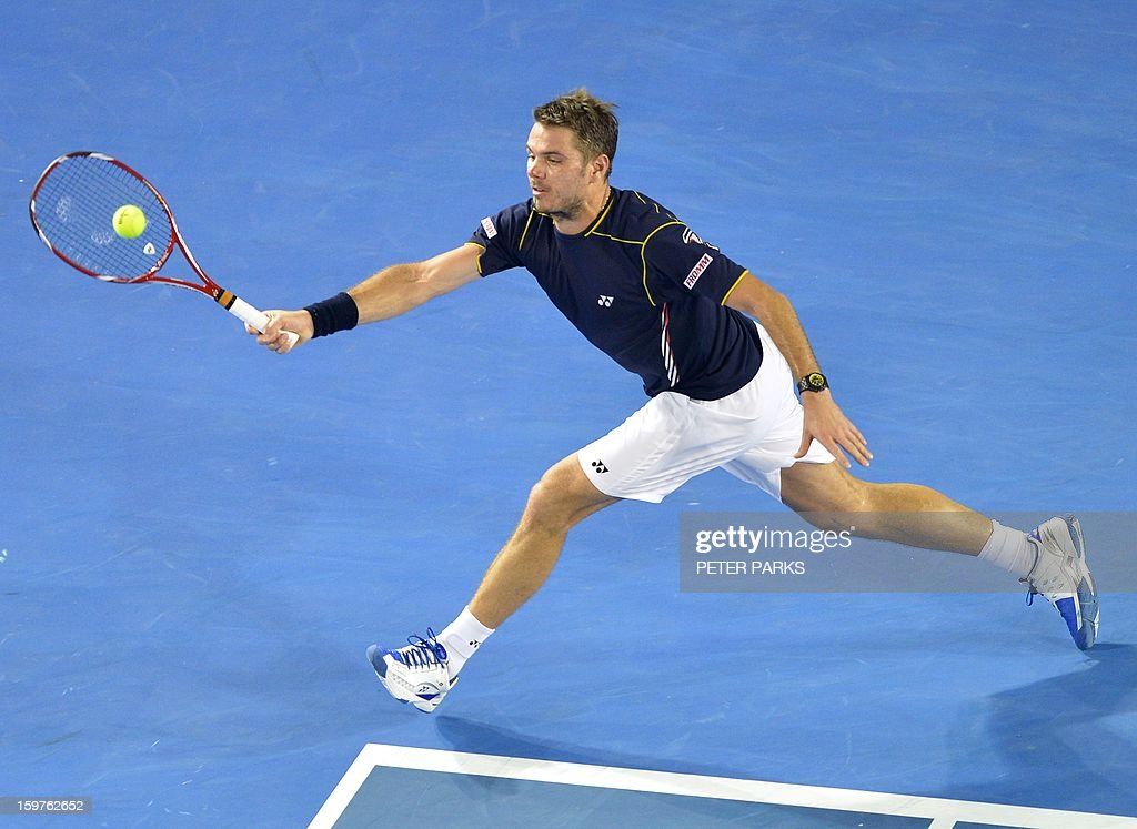 Switzerland's Stanislas Wawrinka hits a return against Serbia's Novak Djokovic during their men's singles match on day seven of the Australian Open tennis tournament in Melbourne on January 20, 2013. AFP PHOTO / PETER PARKS IMAGE STRICTLY RESTRICTED TO EDITORIAL USE - STRICTLY NO COMMERCIAL USE