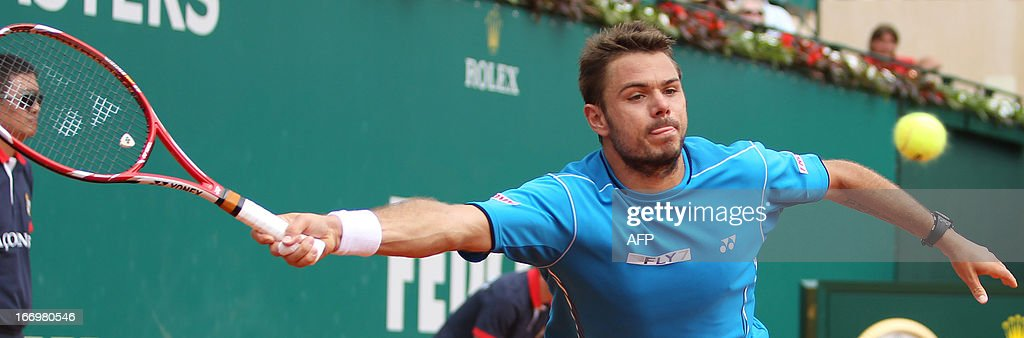 Switzerland's Stanislas Wawrinka hits a return during his match against France's Jo-Wilfried Tsonga at the Monte-Carlo ATP Masters Series Tennis Tournament on April 19, 2013, in Monaco.