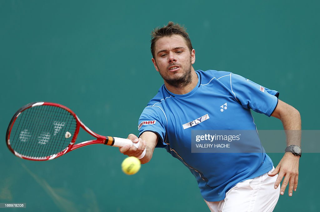 Switzerland's Stanislas Wawrinka hits a return to France's Jo Wilfried Tsonga during their Monte-Carlo ATP Masters Series Tournament tennis match on April 19, 2013 in Monaco.