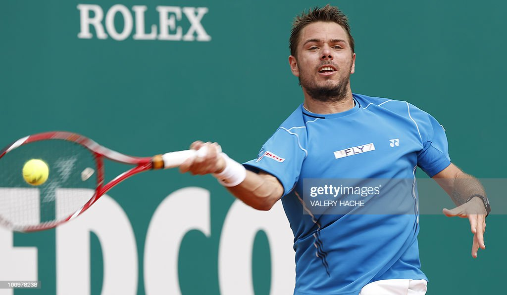 Switzerland's Stanislas Wawrinka hits a return to France's Jo Wilfried Tsonga during their Monte-Carlo ATP Masters Series Tournament tennis match on April 19, 2013 in Monaco. AFP PHOTO / VALERY HACHE