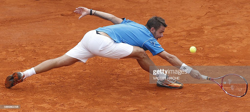 Switzerland's Stanislas Wawrinka hits a return to France's Jo Wilfried Tsonga during a Monte-Carlo ATP Masters Series Tournament tennis match on April 19, 2013 in Monaco.