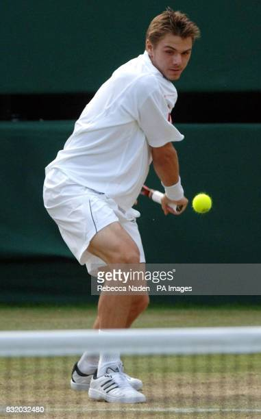 Switzerland's Stanislas Wawrinka in action against Croatia's Mario Ancic during the third round of The All England Lawn Tennis Championships at...
