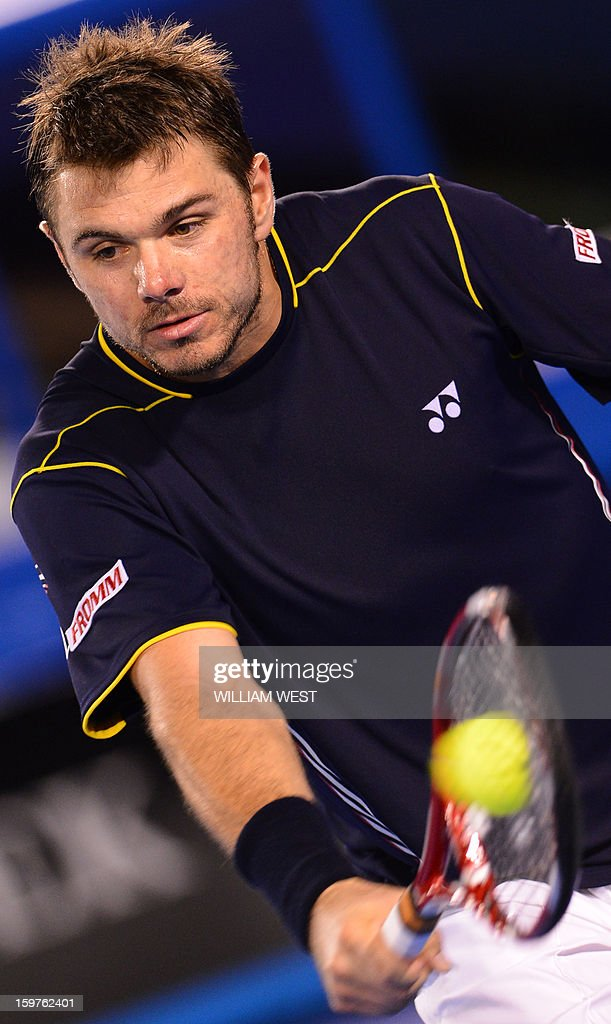Switzerland's Stanislas Wawrinka plays a return during his men's singles match against Serbia's Novak Djokovic on the seventh day of the Australian Open tennis tournament in Melbourne on January 20, 2013.