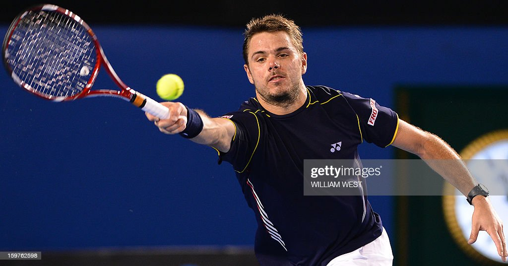 Switzerland's Stanislas Wawrinka plays a return during his men's singles match against Serbia's Novak Djokovic on the seventh day of the Australian Open tennis tournament in Melbourne on January 20, 2013. AFP PHOTO/WILLIAM WEST IMAGE STRICTLY RESTRICTED TO EDITORIAL USE - STRICTLY NO COMMERCIAL USE