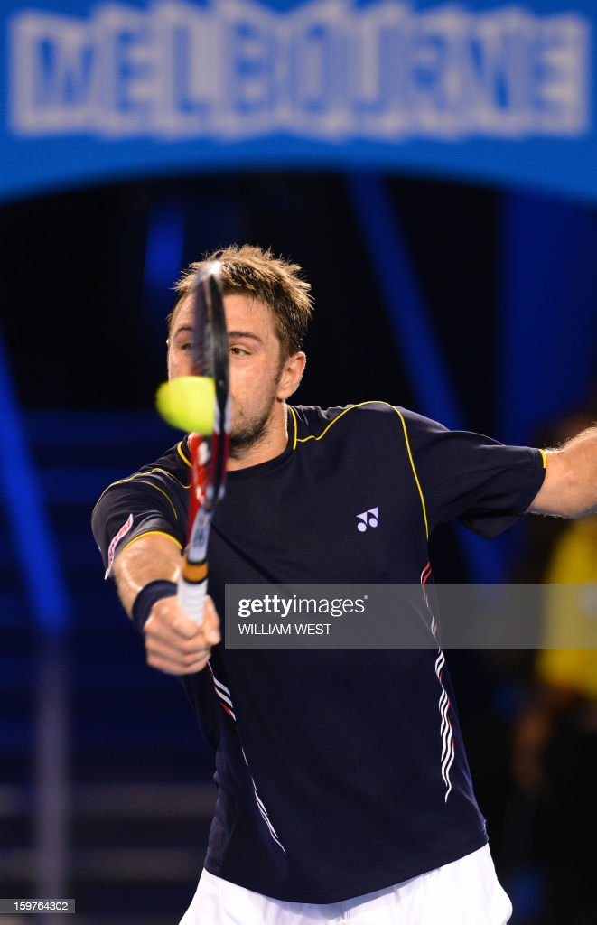 Switzerland's Stanislas Wawrinka plays a return during his men's singles match against Serbia's Novak Djokovic on the seventh day of the Australian Open tennis tournament in Melbourne early January 21, 2013.