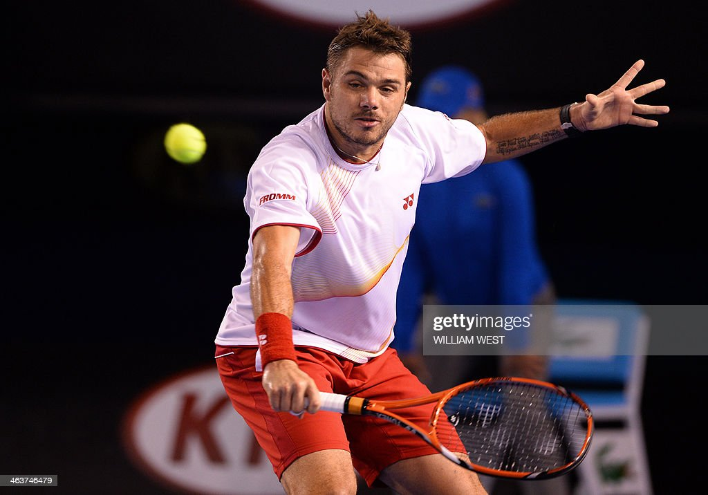 Switzerland's Stanislas Wawrinka plays a shot during his men's singles match against Spain's Tommy Robredo on day seven of the 2014 Australian Open tennis tournament in Melbourne on January 19, 2014. IMAGE RESTRICTED TO EDITORIAL USE - STRICTLY NO COMMERCIAL USE AFP PHOTO / WILLIAM WEST