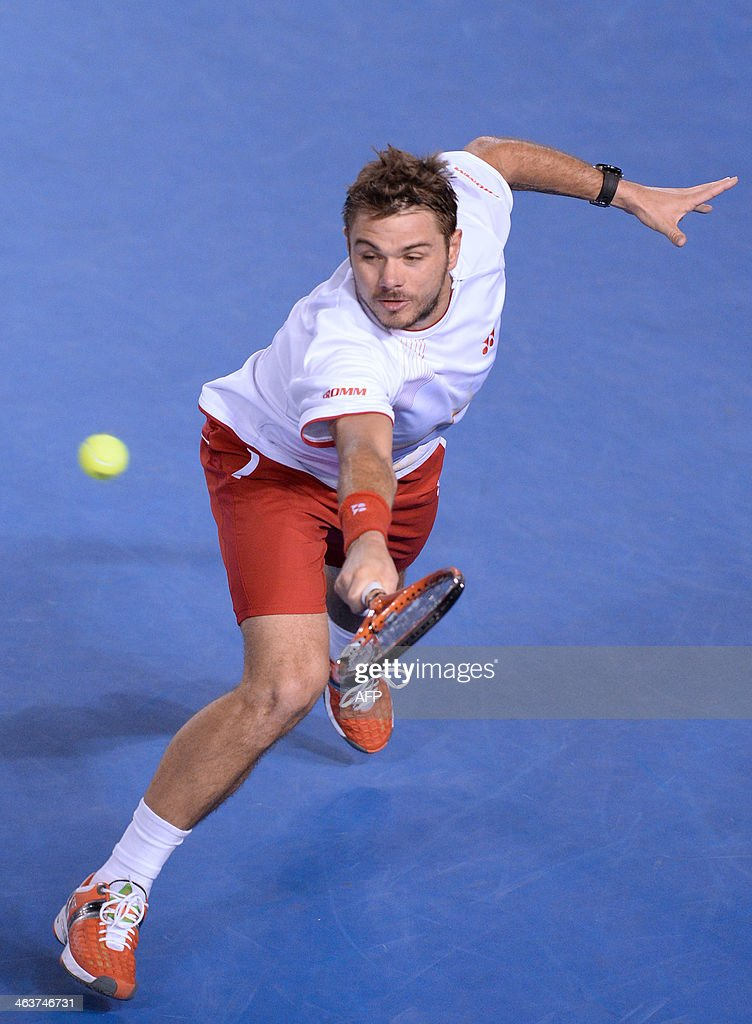Switzerland's Stanislas Wawrinka plays a shot during his men's singles match against Spain's Tommy Robredo on day seven of the 2014 Australian Open tennis tournament in Melbourne on January 19, 2014. IMAGE