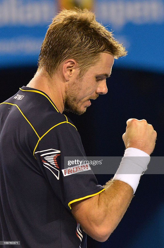 Switzerland's Stanislas Wawrinka reacts after a point against Serbia's Novak Djokovic during their men's singles match on day seven of the Australian Open tennis tournament in Melbourne on January 20, 2013.