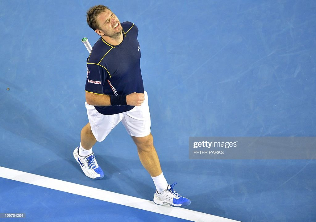Switzerland's Stanislas Wawrinka reacts after a point against Serbia's Novak Djokovic during their men's singles match on day seven of the Australian Open tennis tournament in Melbourne early on January 21, 2013.