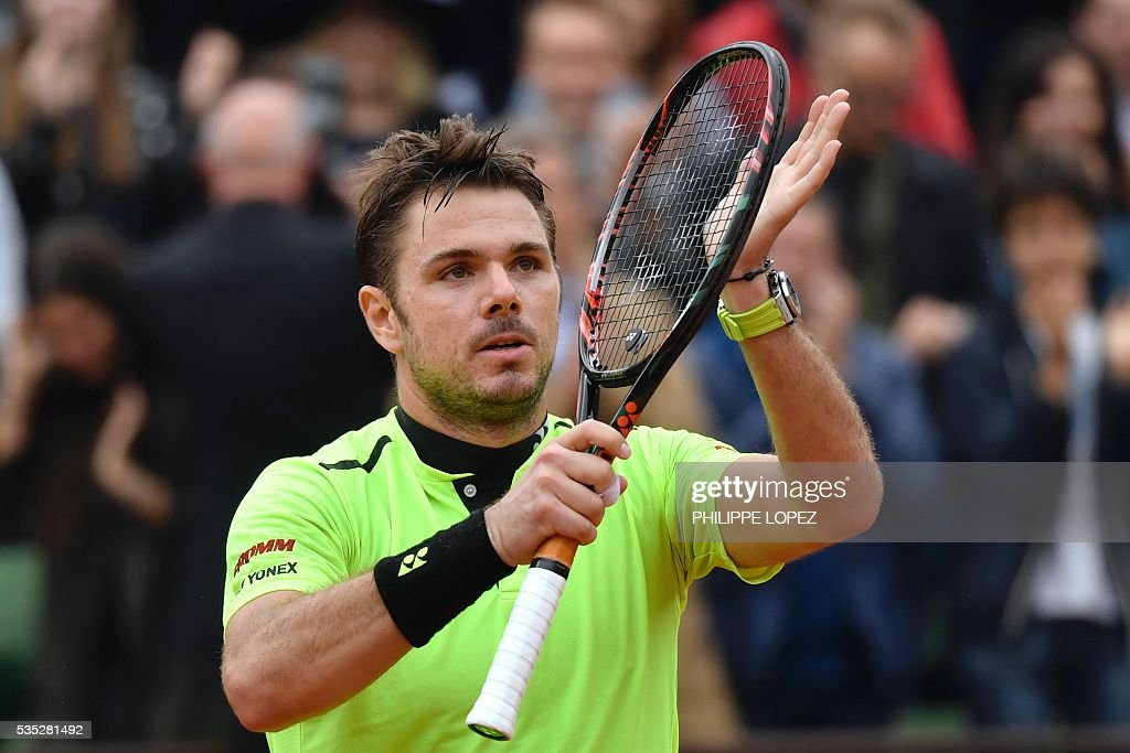 Switzerland's Stanislas Wawrinka reacts after winning his men's fourth round match against Serbia's Victor Troicki at the Roland Garros 2016 French Tennis Open in Paris on May 29, 2016. / AFP / PHILIPPE
