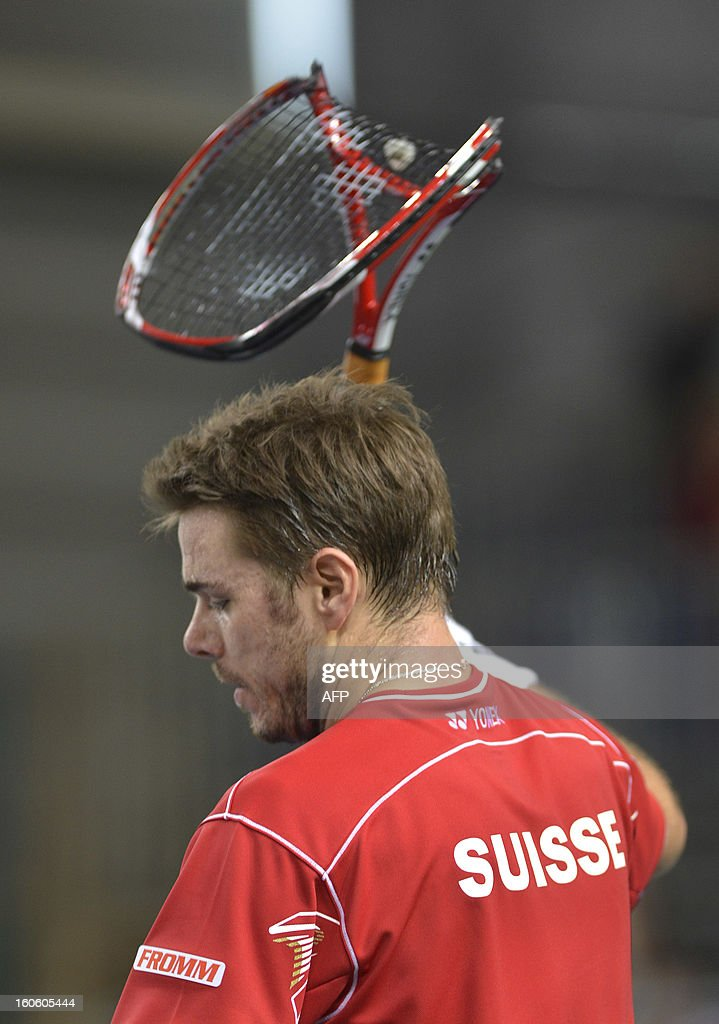 Switzerland's Stanislas Wawrinka reacts as he broke his racquet during a Davis Cup World Group first round tennis game against his Czech's opponent Tomas Berdych on February 3, 2013 in Geneva.