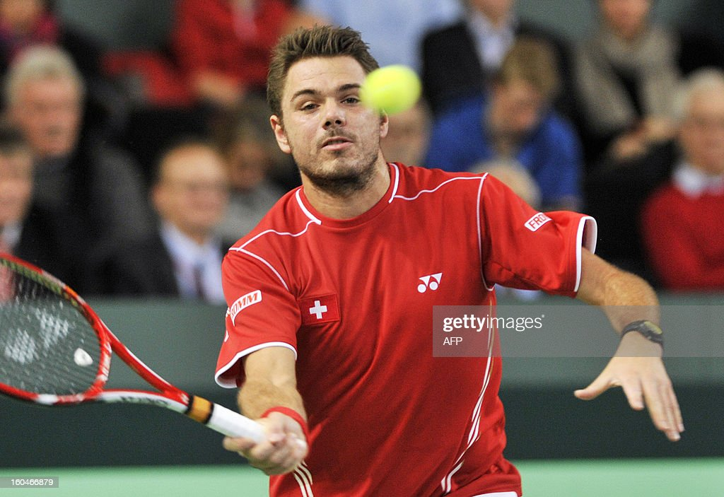 Switzerland's Stanislas Wawrinka returns the ball to his Czech's opponent Lukas Rosol during a Davis Cup World Group first round match Switzerland vs Czech Republic on February 1, 2013 in Geneva.