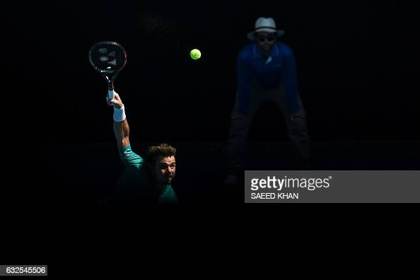 TOPSHOT Switzerland's Stanislas Wawrinka serves against France's JoWilfried Tsonga during their men's singles quarterfinal match on day nine of the...