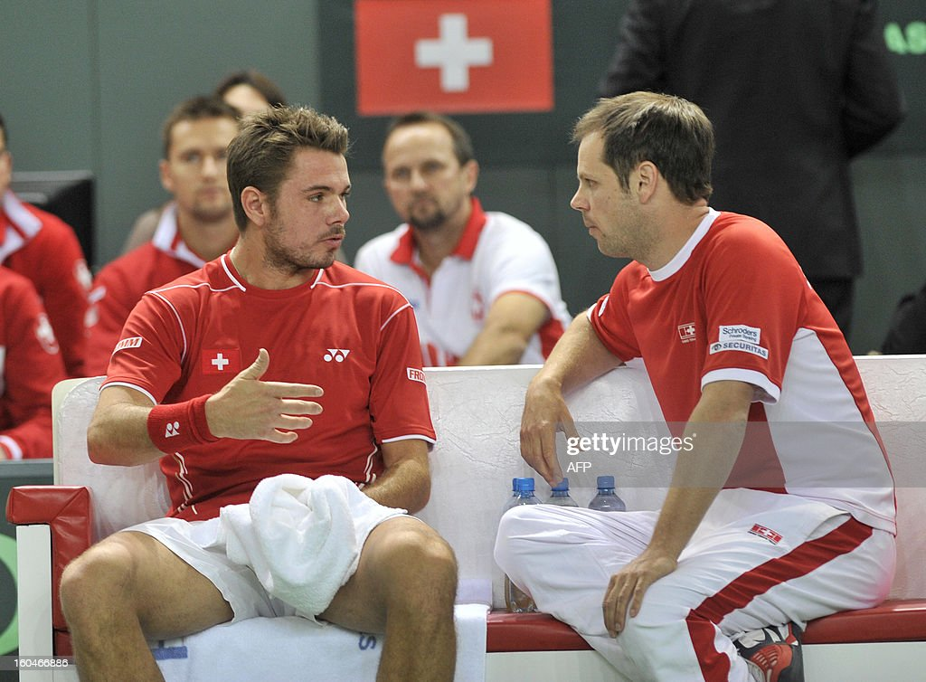 Switzerland's Stanislas Wawrinka talks to Swiss captain Severin Luethi during a Davis Cup World Group first round tennis match Switzerland vs Czech Republic against Czech's Lucas Rosol on February 1, 2013 in Geneva.