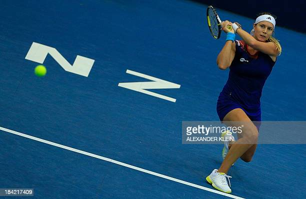 Switzerland's Stefanie Voegele returns the ball to Serbia's Ana Ivanovic during their semi final match of the WTA tennis tournament in Linz on...